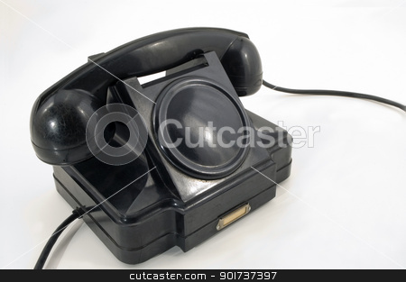 Old Phone. stock photo, The old telephone of black colour on a white background. by Yury Ponomarev