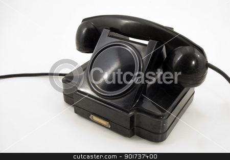 Old Phone. stock photo, Old-fashioned black telephone receiver with cord on white background by Yury Ponomarev