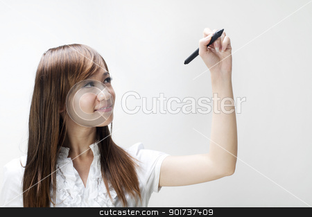 drawing  stock photo, Young woman drawing on grey background  by szefei