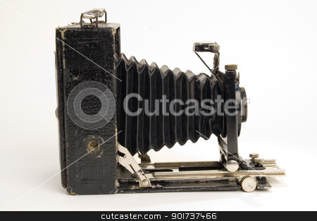 Old classical camera with furs. stock photo, The old photographic chamber with a lens of furs on a white background.  by Yury Ponomarev