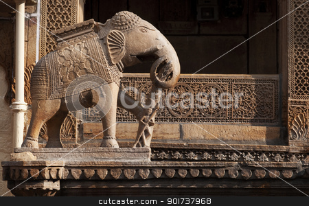 Elephant statue stock photo, An elephant statue guards one of the structures at Jaisalmer's City in Rajasthan, India. by szefei