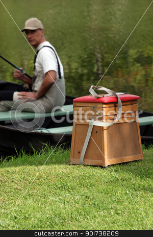 gentleman seated in boat fishing stock photo, gentleman seated in boat fishing by photography33