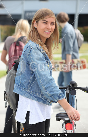 Smiling teenage girl with bicycle stock photo, Smiling teenage girl with bicycle by photography33