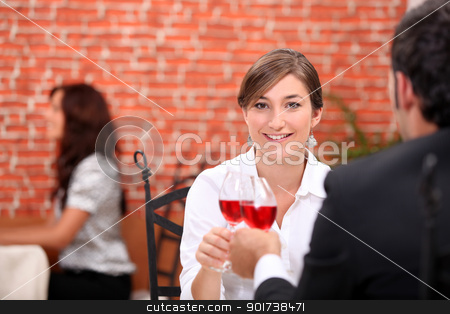 Couple enjoying romantic meal in restaurant stock photo, Couple enjoying romantic meal in restaurant by photography33
