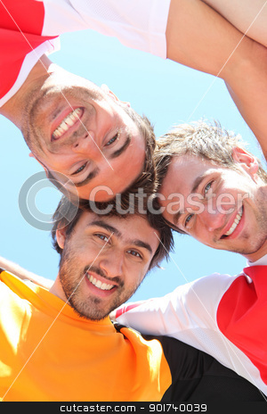 Players with heads together stock photo, Players with heads together by photography33