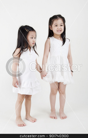 Sisters love stock photo, Asian sisters holding hand on plain background by szefei