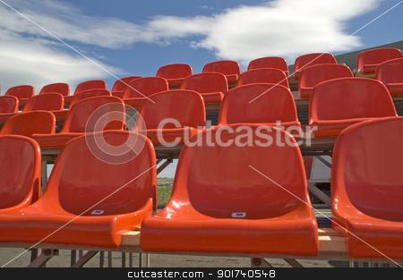 Red seats. stock photo, Red seats on a background of the sky with clouds. by Yury Ponomarev
