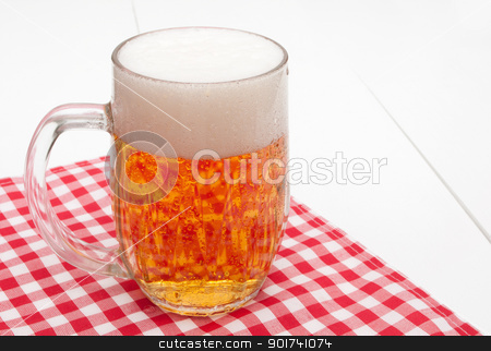 Glass of Beer stock photo, Glass of Beer on Red Gingham Tablecloth by JAMDesign