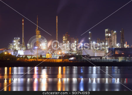 Petrochemical plant in night  stock photo, night scene of petrochemical plant with water reflection by Ioan Panaite