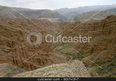 Red canyon. stock photo, Red canyon. Dry channel of the river on a background of red mountains. by Yury Ponomarev