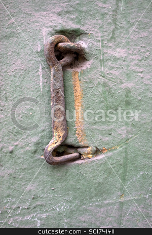 Old metal hook. stock photo, Old wall with a metal hook. by Yury Ponomarev