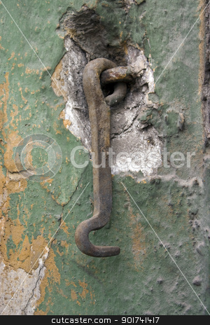 Wall with a hook. stock photo, Old wall with a metal hook. by Yury Ponomarev