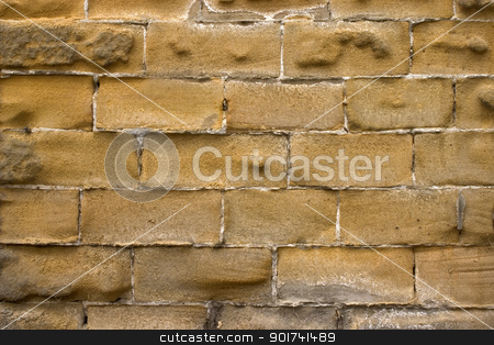 Wall. stock photo, Old wall of a yellow brick. by Yury Ponomarev