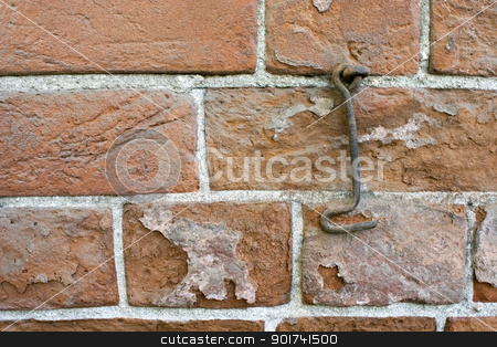Brick wall. stock photo, Brick wall and old metal hook. by Yury Ponomarev
