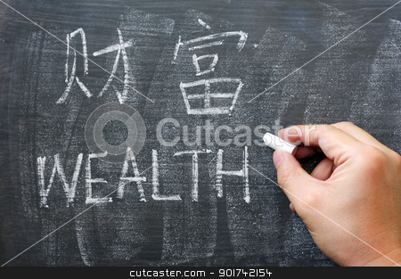 Wealth - word written on a blackboard with a Chinese version stock photo, Wealth - word written on a smudged blackboard with a Chinese version by John Young