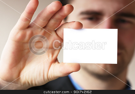 man shows his business card stock photo, Businessman holding his business card in hand by Viktor Thaut