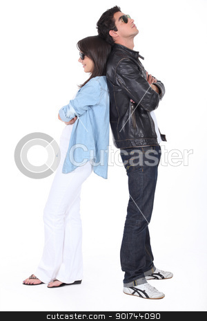 Young couple back to back in sunglasses and leather jacket stock photo, Young couple back to back in sunglasses and leather jacket by photography33