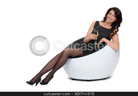 Woman drinking champagne stock photo, Woman drinking champagne by photography33