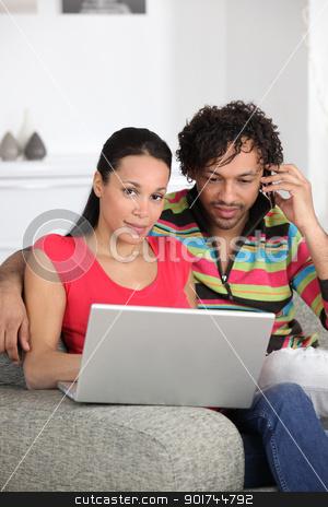 Couple enjoying modern technology stock photo, Couple enjoying modern technology by photography33