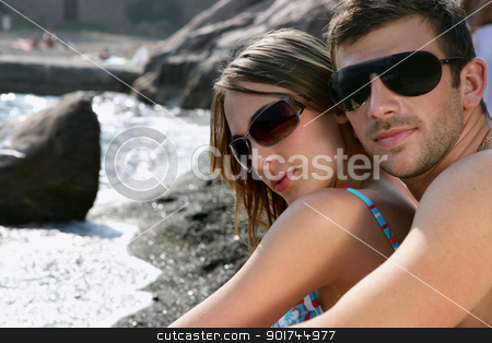 Couple stood by beach stock photo, Couple stood by beach by photography33