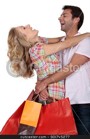 An elated couple embracing stock photo, An elated couple embracing by photography33