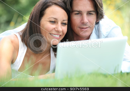 Couple on laptop stock photo, Couple on laptop by photography33