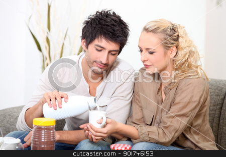 Couple drinking milk stock photo, Couple drinking milk by photography33