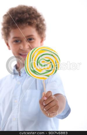 portrait of a little boy with lollipop stock photo, portrait of a little boy with lollipop by photography33