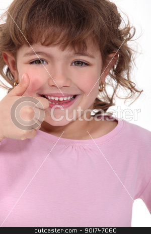 Little girl giving thumbs-up stock photo, Little girl giving thumbs-up by photography33
