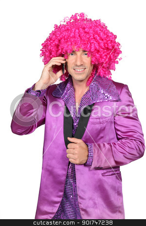 Man in Seventies costume and crazy wig on cellphone stock photo, Man in Seventies costume and crazy wig on cellphone by photography33