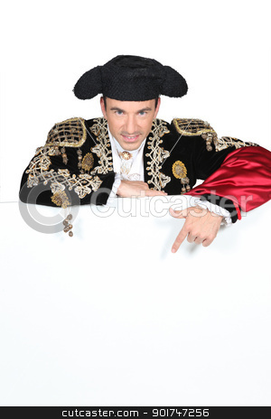 Man in a matador costume with a board blank for text or image stock photo, Man in a matador costume with a board blank for text or image by photography33
