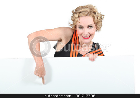 blonde woman pointing panel stock photo, blonde woman pointing panel by photography33