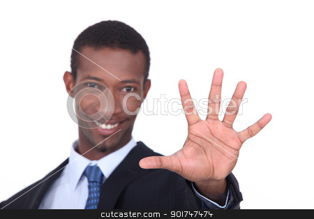 Studio shot of a businessman with the palm of his hand outstretched in front of him stock photo, Studio shot of a businessman with the palm of his hand outstretched in front of him by photography33