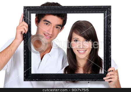 Couple holding empty picture frame stock photo, Couple holding empty picture frame by photography33