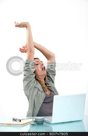 Woman yawning at desk stock photo, Woman yawning at desk by photography33