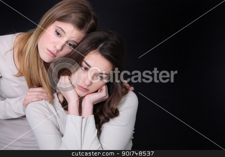 Young woman trying to comfort her friend stock photo, Young woman trying to comfort her friend by photography33