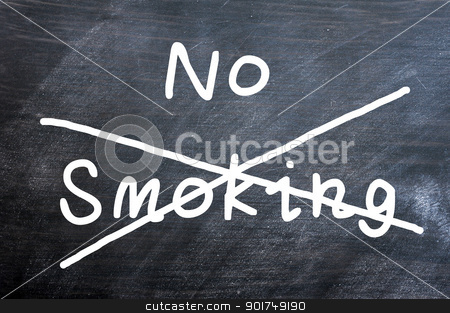 No smoking written on a smudged blackboard stock photo, No smoking written on a smudged blackboard with a cross by John Young