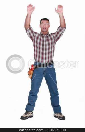 Tradesman reaching for an object stock photo, Tradesman reaching for an object by photography33