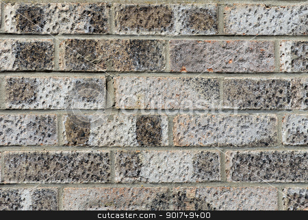 Textured brick wall stock photo, Abstract background of textured gray or grey brick wall. by Martin Crowdy