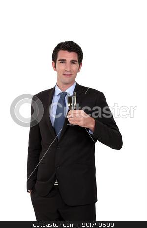Businessman holding champagne glass stock photo, Businessman holding champagne glass by photography33