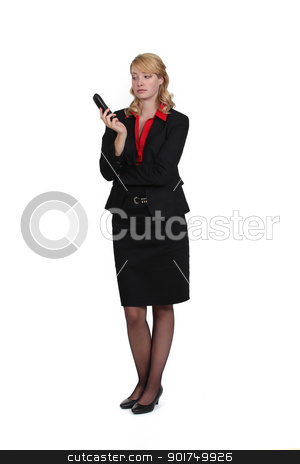 A businesswoman depressed after a phone conversation. stock photo, A businesswoman depressed after a phone conversation. by photography33