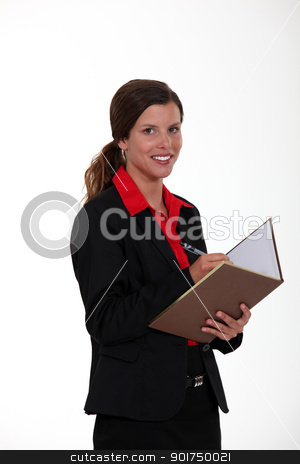 Woman writing in a book stock photo, Woman writing in a book by photography33