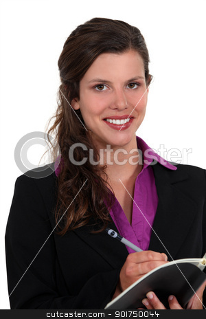 Businesswoman writing in a notepad stock photo, Businesswoman writing in a notepad by photography33