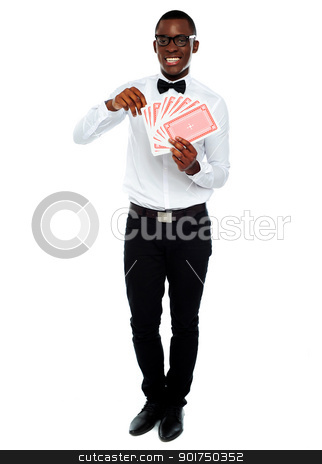 Portrait of a young man holding cards stock photo, Full length portrait of a young man holding cards by Ishay Botbol