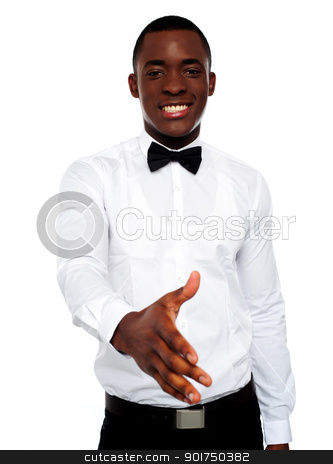 Attractive young man offering handshake stock photo, Attractive young man offering handshake to you by Ishay Botbol