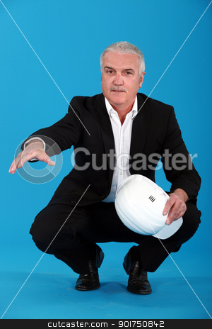 Grey haired architect crouching and offering to shake hand stock photo, Grey haired architect crouching and offering to shake hand by photography33