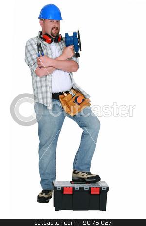 Handyman holding power sander stock photo, Handyman holding power sander by photography33