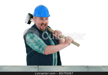 Builder hitting a wall with a sledgehammer stock photo, Builder hitting a wall with a sledgehammer by photography33