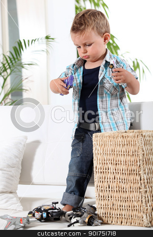 Little boy playing with toy cars stock photo, Little boy playing with toy cars by photography33