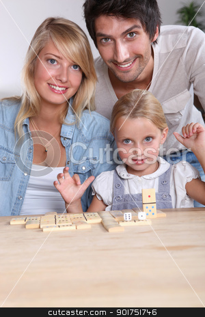 Parents and daughter playing dominoes stock photo, Parents and daughter playing dominoes by photography33